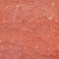 röd grov sten textur bakgrund. foto