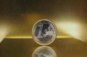 1 euromynt, Europeiska unionen över guldbakgrund foto