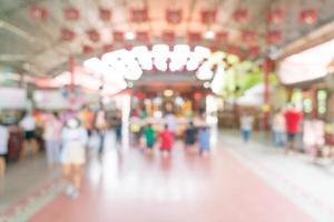 abstrakt oskärpa människor vid helgedom för bakgrund foto