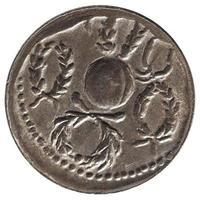 forntida romerskt mynt isolerat över vitt foto