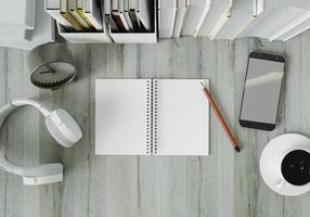 ett arbetsrum med böcker placerade på ett vitt bord med hörlurar foto