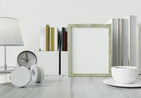 ett arbetsrum med en bok placerad på ett vitt bord med en bildram. foto