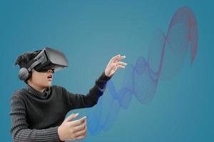 asiatisk pojke bär vr -glasögon headset foto