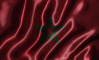 tapeter av marockos flagga och viftande flagga av tyg. foto
