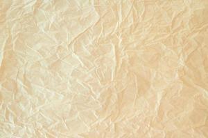 bakgrund textur brunt papper med rynkor foto
