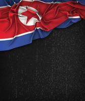 Nordkoreas flagga årgång på en svart grunge tavla foto