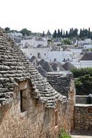 stadsbild av typiska Trulli -hus i Alberobello Italien foto