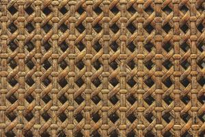 närbild av träkorg gjord av ratten textur bakgrund foto