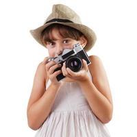 flicka med en filmkamera foto