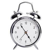 fem minuter till fem på en väckarklocka foto