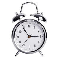 fem minuter till tre på en väckarklocka foto