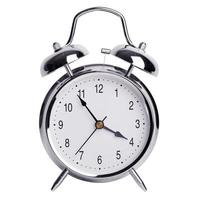 fem minuter till fyra på en väckarklocka foto