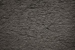 svart stenyta med liten grovhet foto