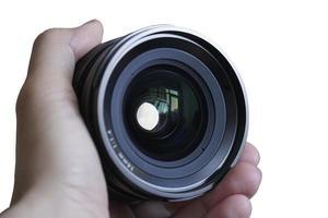 främsta objektiv på handen isolerad på vit bakgrund foto