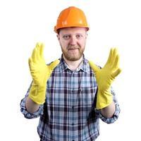 man i hjälm och gula handskar foto