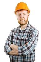 arbetare i orange hjälm och plädskjorta foto