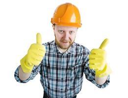 man i en orange konstruktionshjälm och handskar foto