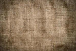 närbild av brun säckväv textur kan använda som bakgrund foto