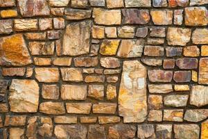 vägg dekorerad med sten för bakgrund. foto