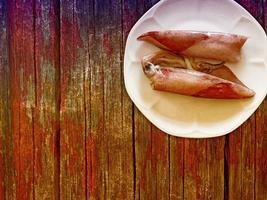 bläckfisk på träbakgrund foto