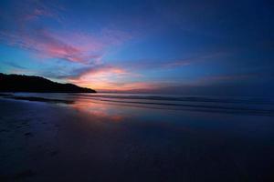 solnedgångstrand foto