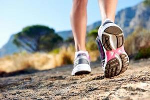 trail running kvinna foto