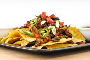 chili-ost nacho mellanmål foto