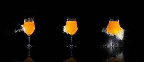 exploderade glas med apelsinjuice foto
