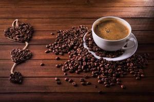 kaffekopp och bönor foto