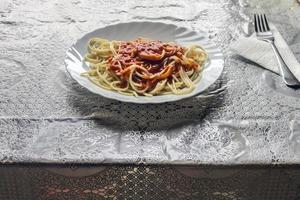 spaghetti med tomater foto