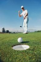 sätta golf man foto