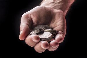 pengarmynt i handen foto
