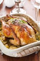 rostad kyckling med potatis foto