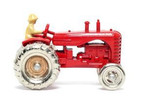 gammal leksaksbil massey harris traktor foto