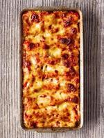 rustik italiensk bakad spenat ricotta cannelloni pasta foto