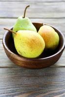 honungspäron i en skål foto