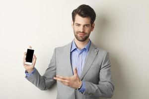 affärsman med mobil foto