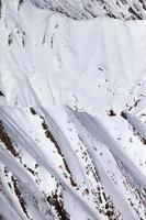 snöiga stenar foto
