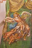 Sevilla - fresco av ängel med rosorna foto