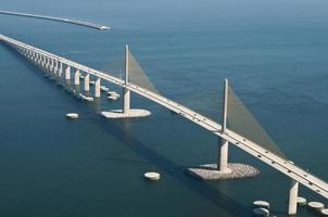 solsken skyway bridge och södra fiskebrygga foto