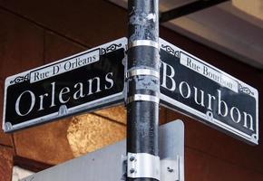 orleans och bourbon gator loggar in nya orleans foto