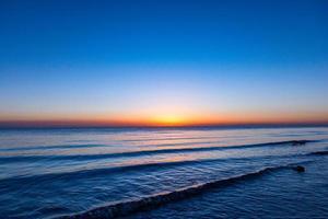 qinghai sjö, soluppgång foto