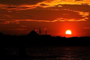 blå moské solnedgång foto