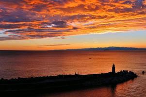 solnedgång fyr foto