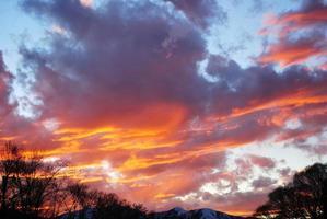 solnedgång vågor foto