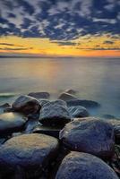 solnedgång och hav foto