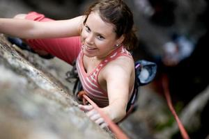 kvinnlig klättrare foto
