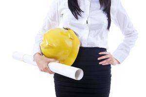 affärskvinna gul hatt och plan foto