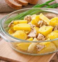 stekt potatis med kyckling foto