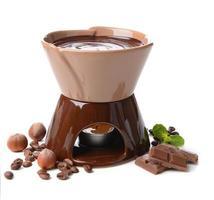 chokladfondue, isolerad på vitt foto